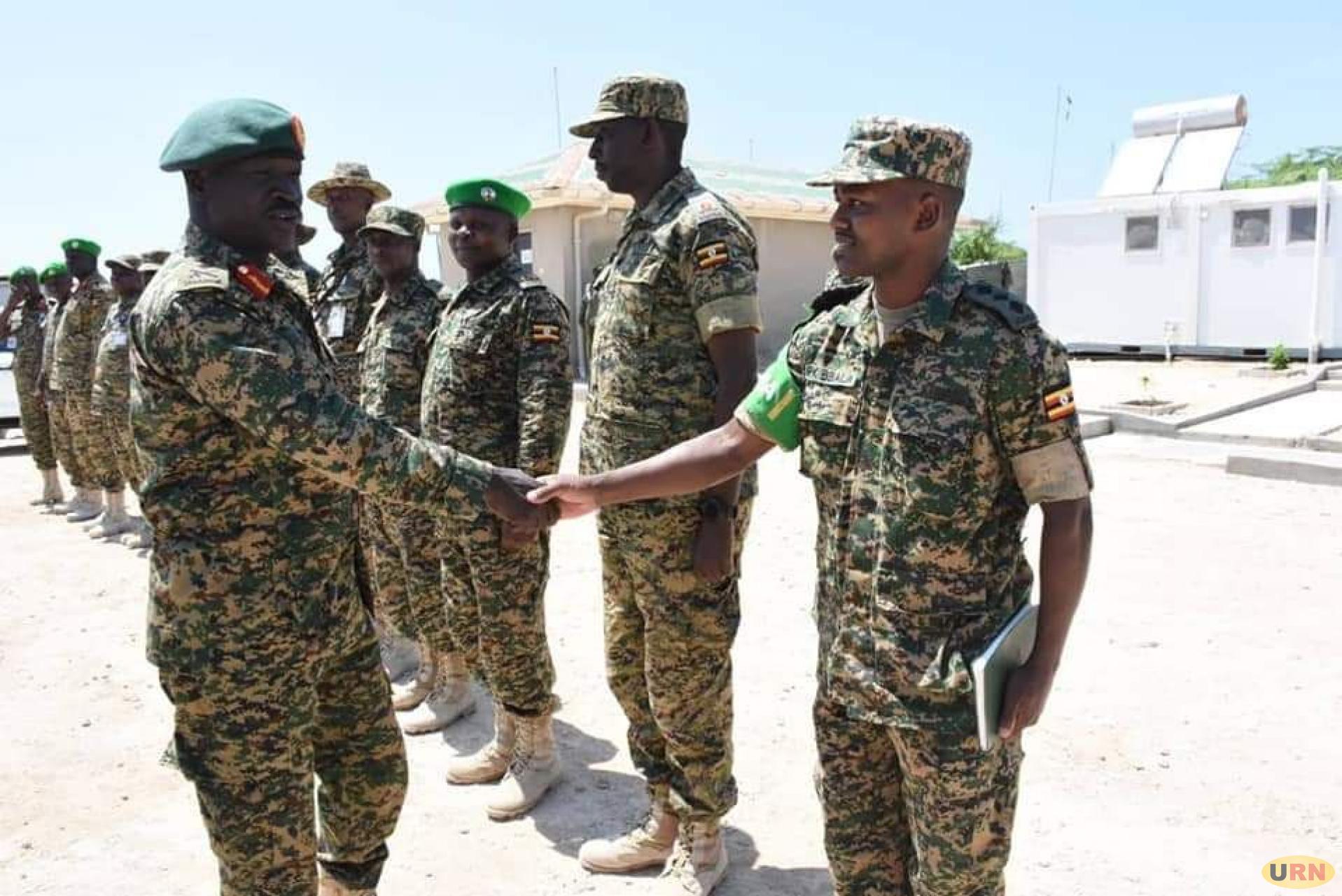Gen Peter Elwelu greeting senior army officer at UPDF Contingent in Somalia